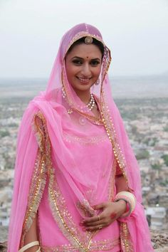 A Rajasthani Bride wearing the dupatta around her shoulders in a traditional drape. Source: Google