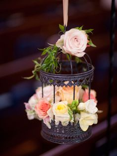 Unexpected flower ideas - Hanging lanterns or birdcages from the trees at your outdoor venue is a nice touch, but take it a step further by having them decked out in flowers for added color and texture.