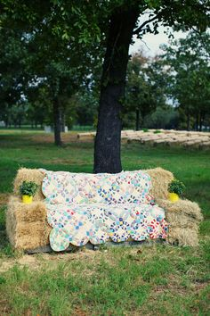Hay bale couch with a quilt!! How about hay bale sits!! I was talking to Ryan's mom about this today! Hehe :)