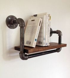 Reclaimed Wood & Pipe Book Shelf 15 Industrial Interior Design Details for an Edgy Downtown Feel https://www.toovia.com/lists/15-industrial-interior-design-details-for-an-edgy-downtown-feel