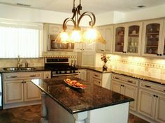 White kithchen cabinets and dark geen countertops