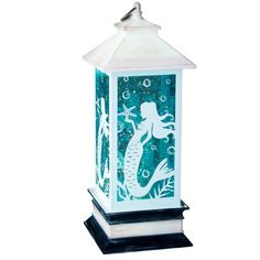 Mermaid Lantern This mermaid lantern adds a magical touch of whimsy! Made of resin and acrylic with an image of a mermaid on all sides. The shimmering liquid inside moves with the help of a gentle blower in the bottom of the lantern to keep it sparkling all night long. A perfect table top piece that