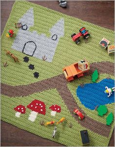 Go There Now Reversible crochet intarsia makes this an interactive no-wrong-side playmat. Mike drives his truck down the bumpy road. He has to get this load to… Crochet Crafts, Yarn Crafts, Crochet Toys, Crochet Projects, Knit Crochet, Crochet Game, Crochet For Kids, Manta Crochet, Tapestry Crochet