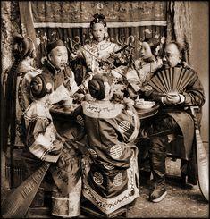 China. Rich Merchants Dining With Singing Girls, Pekin, China, c1901 //  Benjamin W. Kilburn