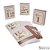 Direct guests to their seats with stylish wedding table numbers in classic black, white, silver or gold. Create your own unique DIY wedding table numbers. Paper Doilies Wedding, Doily Wedding, Wedding Table Number Holders, Wedding Table Numbers, Wedding Supplies, Party Supplies, Gold Table Numbers, Birthday Party Tables, Fun Express