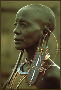This photograph contains an image of a Maasai women. She is adorned in beautiful beadwork and jewelry, that is known to be a symbol of wealth. The Maasai are a semi-nomadic group that makes their home in Kenya. African Tribes, African Women, African Art, Cultures Du Monde, World Cultures, Black Is Beautiful, Beautiful People, Arte Tribal, Art Africain