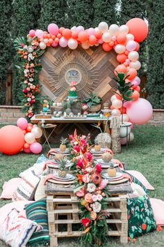 Moana First Birthday Party Ideas and Supplies featured by top US life and style blog, Dress Me Blonde: image of a little girl celebrating her first birthday with a Moana birthday party