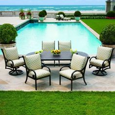 I really want to get some patio furniture. I love the look of a dark metal with lighter cushions. I think I'll go with a baby blue or pink for the backyard. Maybe I could get covers and change them. Patio Dining, Outdoor Dining, Outdoor Decor, Contemporary Dining Sets, Dream Beach Houses, Pergola Designs, Transitional Style, Backyard Patio, Beautiful Homes