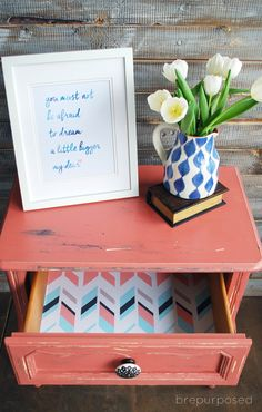 A French Provincial Table get painted in Annie Sloan's Scandinavian Pink with some fun paper lining the drawer! Themed Furniture Makeover Day - brepurposed