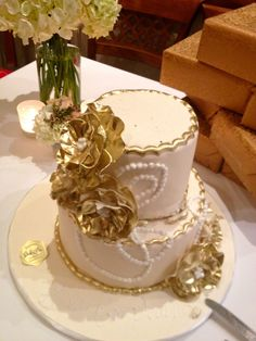 white peach and gold wedding cake two tier mad hatter white and gold wedding cake 27306