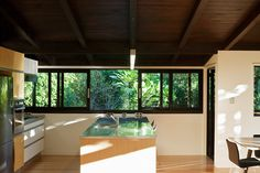 Glade House is located in Remuera, Auckland, New Zealand. Renovation project was conceived and completed by Strachan Group Architects New Zealand Architecture, Sustainable Architecture, Clear Acrylic Sheet, Raked Ceiling, Exposed Rafters, Chimney Breast, Hidden Kitchen, Custom Kitchens, Outdoor Fire
