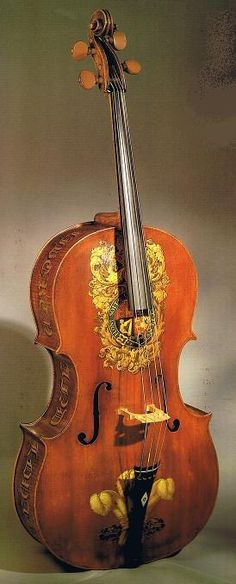 Ornate rich warm wood cello stringed instrument for music joy. Beautiful painted gold decorations around the edges and sound hole. A MOST POPULAR RE-PIN. #DdO:) - http://www.pinterest.com/DianaDeeOsborne/instruments-for-joy  - INSTRUMENTS FOR JOY. Photo pinned via West Coast Classical.