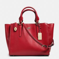 The Crosby Carryall In Leather from Coach So glad they are coming out with more red bags.