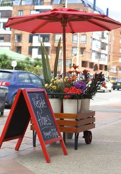 Bogota!!! This  bright and cheerful little cart sets outside our flower store! www.52semanasflores.com