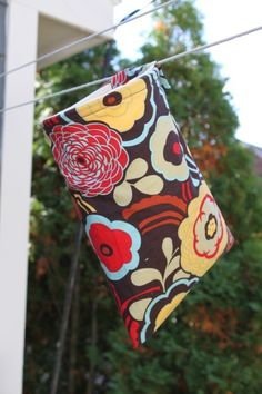 Perfect for storing clothesline/pins when we're not camping and hanging up at the campsite.