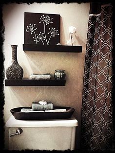 Bathroom Storage. Popular Over Toilet Storage Bathroom Appliance Cabinet Pictures: Nice Black Hardwood Floating Open Shelves Over Toilet Storage For Crafts And Towel Bath Place Store Attach At White Floral Wall Decal In Modern Bathroom Design Ideas