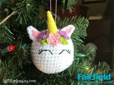 Unicorns are still really popular and lately I have been seeing lots of unicorn Christmas ornaments made with glass balls that have a horn, ears, flowers, and eyes added to it. I decided to make a crocheted version of that ornament. I started by crocheting a round ball and stuffing it with Poly-Fil. Then I used a smaller hook and embroidery floss to crochet small ears, a horn, flowers and leaves and sewed them on. I then embroidererd closed eyes to finish the unicorn. A loop of embroidery…