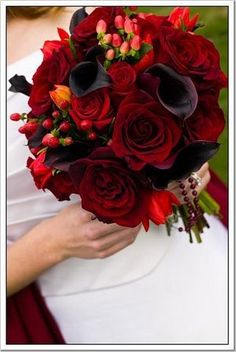 Red and darker red color scheme. These would be close to what I want for bridesmaid flowers.