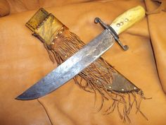 Unknown maker knife and Rawhide sheath