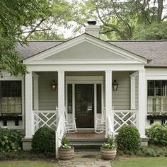 Great covered porch for a small house.  A definite must for my future cottage!  Oh, and I MUST have hydrangeas, too....