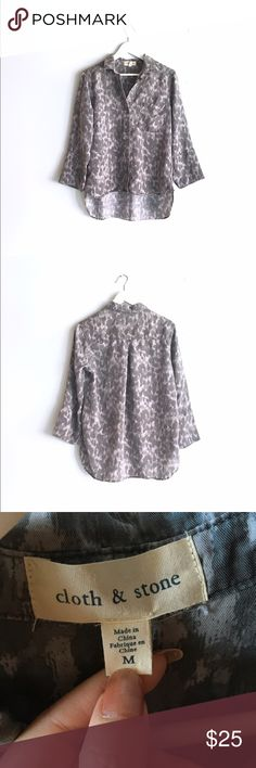 """Cloth & Stone long sleeve top Anthropologie / Cloth & Stone long sleeve button-up top with a beautiful grey brushstroke pattern. Super soft 100% tencel lyocell. High-low effect, longest in back at 28"""" (butt coverage!). Preloved, freshly laundered, still in great condition; last photo notes minor frayed edge and loose threading in the back, unnoticeable when worn. Fits size M. Anthropologie Tops"""