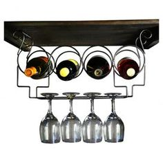 """Showcasing a scrolling openwork design, this under-cabinet rack offers space for stowing four bottles of wine and hanging glasses.   Product: Wine and glass rackColor: Brushed copper Features:  Holds four bottles of wine and four wine glassesEasy to install Dimensions: 9.25"""" H x 21"""" W x 6.5"""" DShipping: This item ships small parcelExpected Arrival Date: Between 04/15/2013 and 04/23/2013Return Policy: This item is final sale and cannot be returned"""