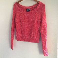 American Eagle Sweater American Eagle Sweater. Size medium reddish/pink with white threading throughout. Worn maybe twice. It fits me more as a crop top and it looks really great with a pair of skinnies and a scarf! American Eagle Outfitters Sweaters Crew & Scoop Necks