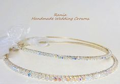 This simple pair is handmade added with swarovski crystals in ab clear colour.  They are all attached on a Silver plated base with silver plated