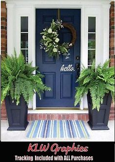 Navy blue front door with tall fern planters That's my brick. I never would have thought navy blue. I love it My Blue Front Door: front door color is Sherwin Williams Naval. The perfect navy blue for entry doors or a front door with sidelights. Painted Front Doors, Front Door Decor, Blue Front Doors, Front Door Paint Colors, Front Porch Planters, Front Entry, Front Door Wreaths, Colored Front Doors, Fern Planters
