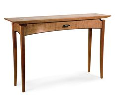 """Cherry, Walnut, and Maple Entry Table. Burke calls this his """"Floating Leg Entry Table"""" because the legs appear to float below the top. The front apron, which is split into three pieces to create a drawer, is reinforced with a brace under the top that's glued and doweled to the side aprons..."""
