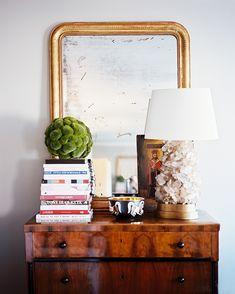 Louis Philippe mirror, wooden chest, gilt mirror, stacked books. By Laurann Claridge.