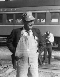 Walt Disney in his favorite role... working on the railroad at Disneyland.