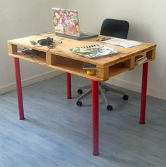 Shipping Pallet Desk  By adding a set of sturdy, colorful table legs (from budget-friendly IKEA), a shipping pallet becomes a functional desk with excellent storage capacity built right in.