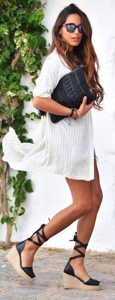 Maria Tilve + summery vibes + striped shirt + over shorts +  swimwear + perfect beach look!   Shirt: Zara, Shorts: Levi's, Espadrilles: Revolve