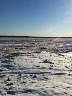 The Yukon river freezing up for the winter in Pilot Station Alaska - the is getting ready to set; it's about 4pm in the fall
