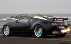 Matte black Bugatti. Love the fire coming out the back.