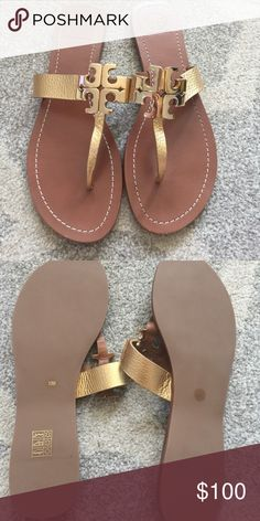 Gold Tory Burch sandals Beautiful metallic gold and brown sandals. Large Tory Burch embellishment. Never worn in perfect condition just too small. It's hard for me to part with these ones! Tory Burch Shoes Sandals