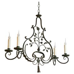 French Wrought Iron Green Painted Four-Arm Chandelier | From a unique collection…