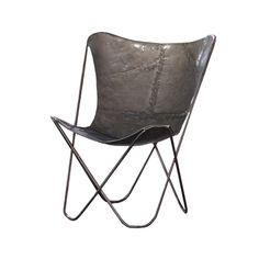 The Iron Sling Chair brings modern design to an ancient material. Inspired by the graceful, curving form of a paperclip, the chair provides a poised presence in any space.  Find the Iron Sling Chair in Raw Metal, as seen in the An Industrial Treasure Hunt Collection at http://dotandbo.com/collections/an-industrial-treasure-hunt?utm_source=pinterest&utm_medium=organic&db_sku=KLL0106-raw