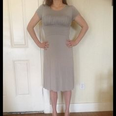 Rachel Pally/Shopbop dress New with tags gray Rachel Pally dress with ruched bust from shopbop. Originally $200. Very cute and flattering-simple with a twist dress. My husband likes it and when I was taking photos of it his friends were over to watch a game and said it was sexy but not trying too hard and a good date night dress. Comfy and flattering. A crowd pleaser for both girls and guys!  Size M and it is stretchy but I say best for a size 4-6. Rachel Pally Dresses