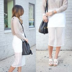 Click the photo to shop the look | Sara of styleMBA wearing a white laser cut midi skirt, and black Alexander Wang bucket bag  | Follow @liketkit on Pinterest for more outfit inspiration #liketkit