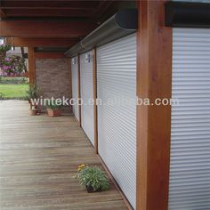 I want roller shutters on every window and door. Rolling Shutter, Roller Shutters, Shutter Doors, Door Gate, Cool Photos, Garage Doors, Exterior, Windows, Outdoor Decor
