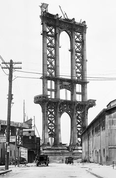Part of the superstructure of the under-construction Manhattan Bridge rises above Washington Street in New York, on June 5, 1908.