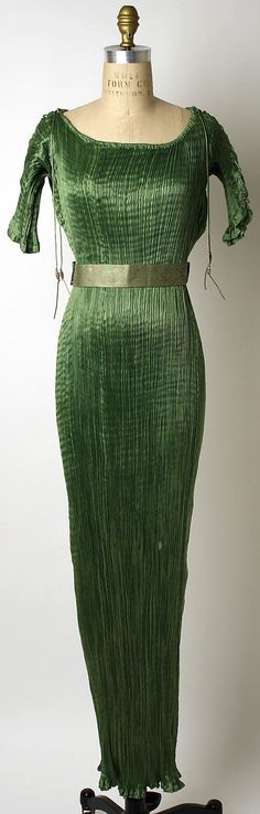 A Fortuny Delphos dress.  With the secret, magical pleats.  So, if there is reincarnation, I want to be reborn skinny, auburn haired, with small (perfect) boobs, so I can wear this dress.