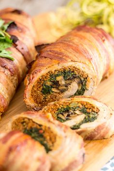 Juicy pork tenderloin stuffed with spicy Italian sausage, spinach and mushrooms, all wrapped up in smokey, crispy bacon. Pork heaven for any pork lover!