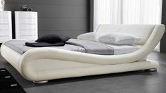 Wake up refreshed in our beautiful Marlo Leather Bed. This low-profile platform bed features softly curving edges and multiple recessed slats that will easily support a wide mattress. The headboard is tilted at a precise ergonomic angle so you can lean on it comfortably before you sleep.