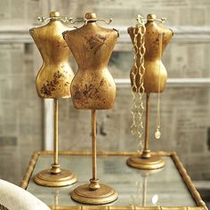 Not vintage but nice! Two's Company Dress Form Jewelry Holder: In gold leaf featuring a flora and fauna design, this dress form will provide a unique and attractive way to hold your jewelry.  Each is slightly different, please let us select one for you.  4 1/2