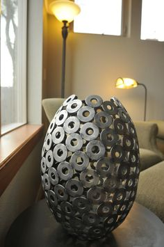Metal sculptural vase - hand welded from from steel structural washers. Make a statement in your home with this industrial artwork!
