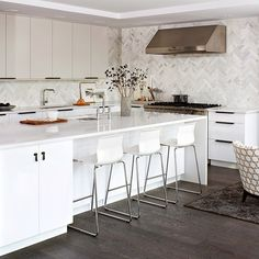 Loving the #herringbone #pattern on that #kitchen #wall. Interior design by Croma Design, Inc \\\ Photo by Virginia McDonald