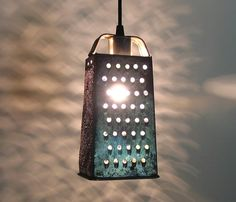 Cheese grater turned pendant